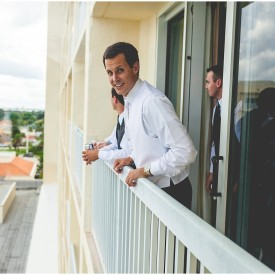 Groom watching fighter jets from his balcony before his Melbourne Florida Wedding.