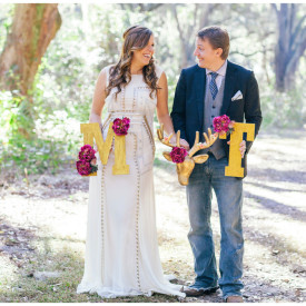bride and groom with some southern props during the bridal portraits.