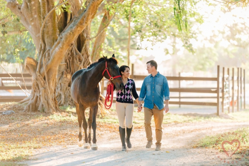 Bride and Groom walking with horse in Homestead Florida