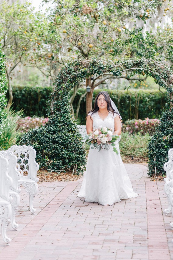 Bride walking down the aisle in Town Manor